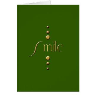 3 Punkt-Goldblock-Lächeln u. grüner Hintergrund Karte