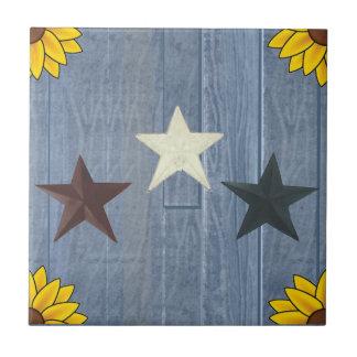 3 Sterne auf blauem Holz Fliese