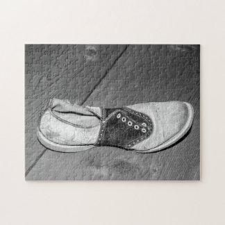 Abgedroschenes Sattel-Schuh-Puzzlespiel Puzzle
