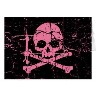 Abgenutzter rosa Totenkopf mit gekreuzter Knochen Karte