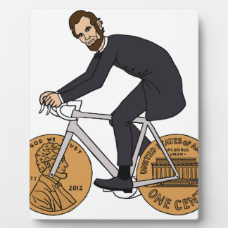 Abraham Lincoln auf einem Fahrrad mit Penny dreht Fotoplatte