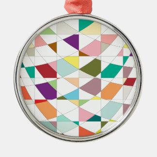 Abstrakte Farbtapisserie Rundes Silberfarbenes Ornament