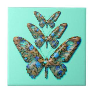 Abstrakte Schmetterlinge auf aquamariner grüner Keramikfliese