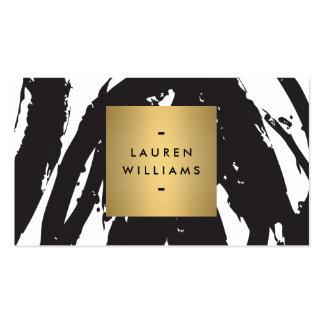 Abstrakte schwarze Brushstrokes mit Goldnamen-Logo Visitenkarten
