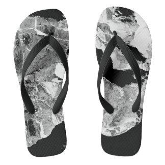 Abstrakte Schwarzweiss-moderne drehen Reinfälle um Flip Flops