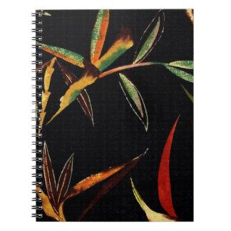 Abstrakter Bambus verlässt grünes orange Spiral Notizblock
