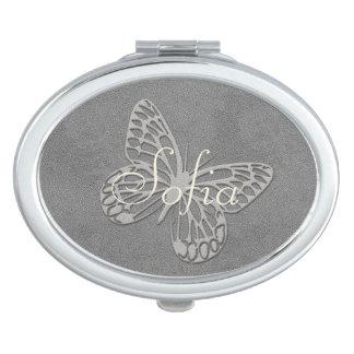 Abstrakter silbernes Grau-Schmetterling addieren Schminkspiegel