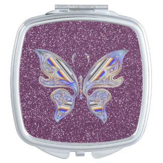 Abstrakter stilvoller Schmetterling auf lila Schminkspiegel
