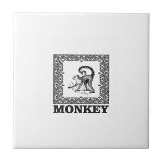 Affe in einem Kasten Fliese