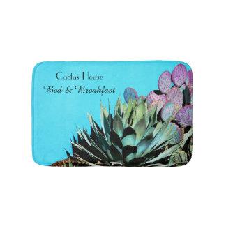 Agaven-und Kaktusfeige-Kaktus auf Türkis-Wand Badematte