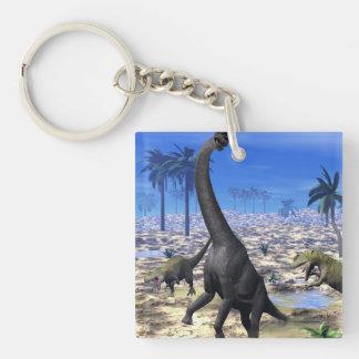 Allosaurus angreifender Brachiosaurusdinosaurier - Schlüsselanhänger