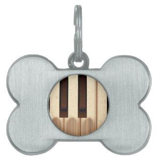 Alte getragene Klavier-Schlüssel Tiermarke