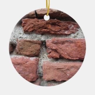 Alter Backsteinmauerhintergrund Rundes Keramik Ornament