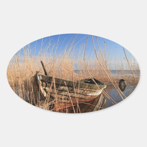 Altes hölzernes Boot in den Schilfen Stickers