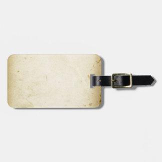 Altes Pergament befleckter gelb gefärbter Vintager Kofferanhänger