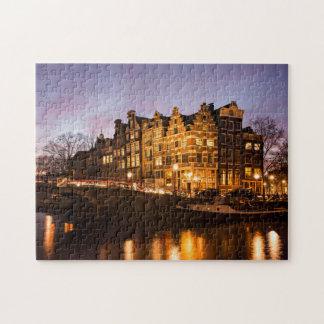 Amsterdam-Kanalhäuser am Puzzlen der Dämmerung Puzzle
