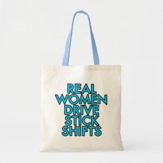 AntriebsSchalthebel der wirklichen Frauen Einkaufstaschen