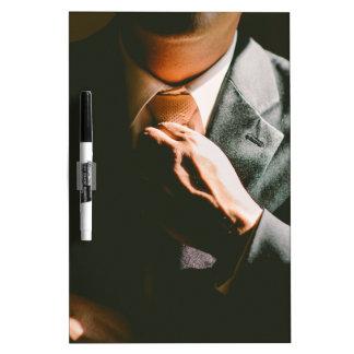 Anzugsgeschäftsmann-Krawatten-Schatteneffekt Trockenlöschtafel