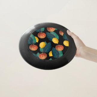Äpfel und Zitronenschwarzes Wham-O Frisbee