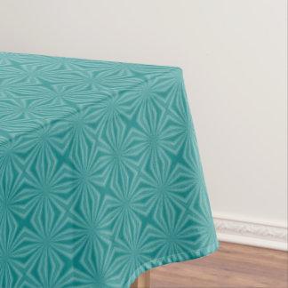 Aquamarine Squiggly Quadrat-Initiale auf weißem Tischdecke