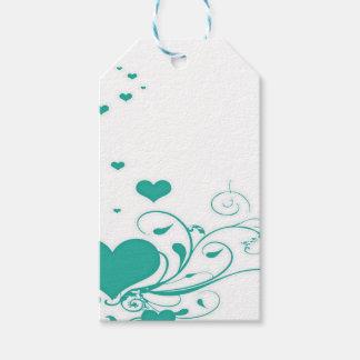 Aquamarine-Valentinsgruß-Herzen auf einem weißen Geschenkanhänger