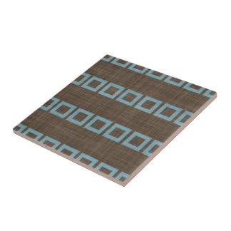 Aquamarines blaues Quadrat-Muster auf dunklem Fliese
