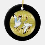 Asiatische Tanzen-Kräne auf goldenem Kreis Ornamente