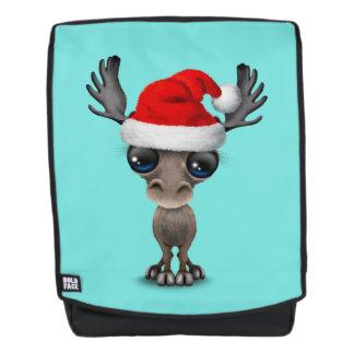 Baby-Elche, die eine Weihnachtsmannmütze tragen Rucksack