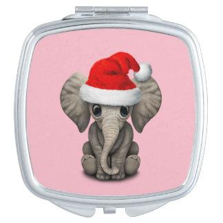 Baby-Elefant, der eine Weihnachtsmannmütze trägt Schminkspiegel