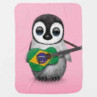 Baby-Pinguin, der brasilianisches Puckdecke