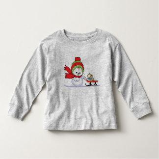 Baby-Schneemann, der Wagen drückt Hemd