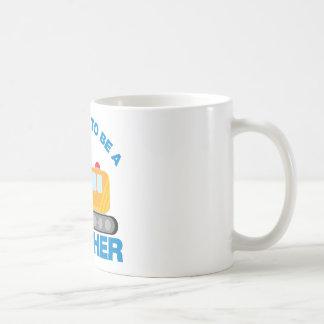 Bagger-LKW, der geht, ein großer Bruder zu sein Kaffeetasse