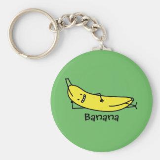 Banane, die lächelnd ist und und entspannend schlüsselanhänger