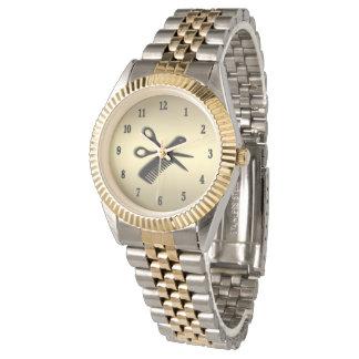Beautician-/Friseur-Entwurfs-Gold mit schwarzen Uhr