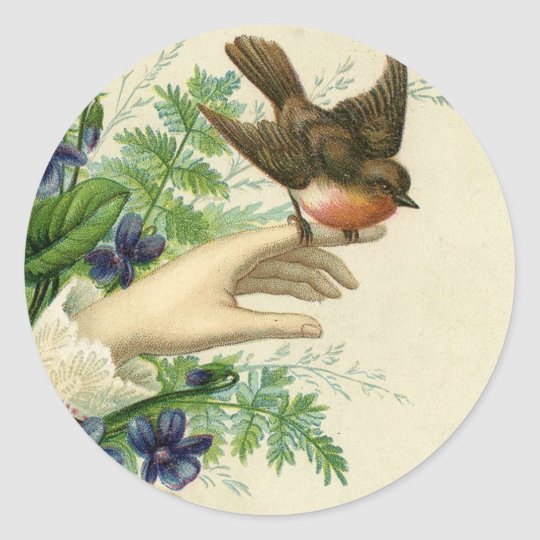 Beautiful hand with a bird and flowers runder aufkleber