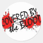 Bedeckt durch das Blut