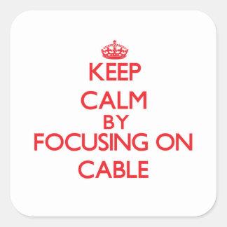 Behalten Sie Ruhe, indem Sie auf Kabel sich Quadratischer Aufkleber