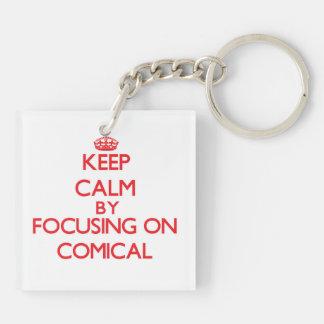 Behalten Sie Ruhe, indem Sie auf komisches sich Schlüsselanhängern