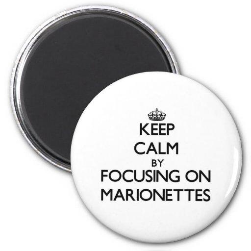 Behalten Sie Ruhe, indem Sie auf Marionetten sich Magnets