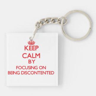 Behalten Sie Ruhe indem Sie auf Sein unzufrieden Schlüsselring