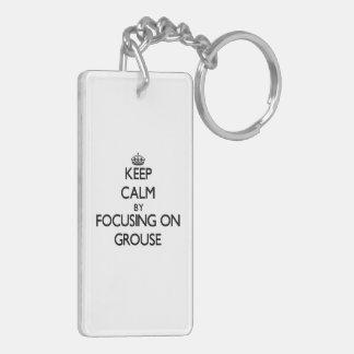 Behalten Sie Ruhe, indem Sie auf Waldhuhn sich Schlüsselanhänger