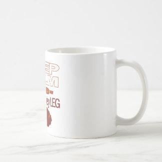 Behalten Sie Ruhe und essen Sie ein die Kaffeetasse