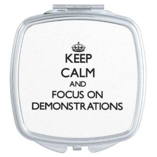 Behalten Sie Ruhe und Fokus auf Demonstrationen Taschenspiegel