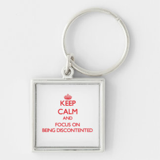 Behalten Sie Ruhe und Fokus auf Sein unzufrieden Schlüsselanhänger