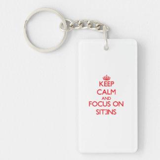 Behalten Sie Ruhe und Fokus auf Sitzen-Ins Schlüsselring