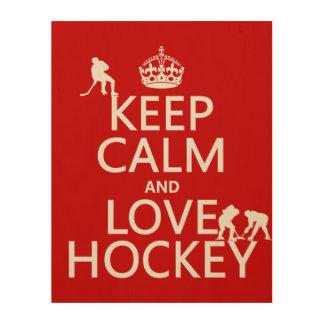 Behalten Sie Ruhe und Hockey an Holzleinwand