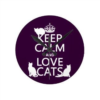 Behalten Sie Ruhe-und Liebe-Katzen (in irgendeiner Runde Wanduhr
