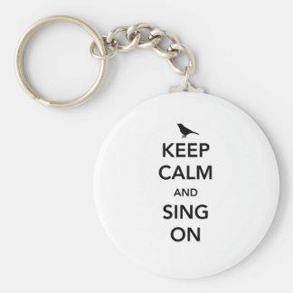 Behalten Sie Ruhe und singen Sie an Schlüsselanhänger