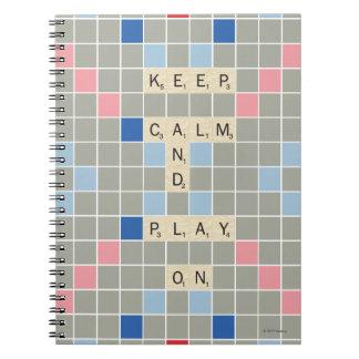 Behalten Sie Ruhe und Spiel an Spiral Notizblock