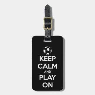 Behalten Sie Ruhe und Spiel auf Schwarzem Gepäckanhänger